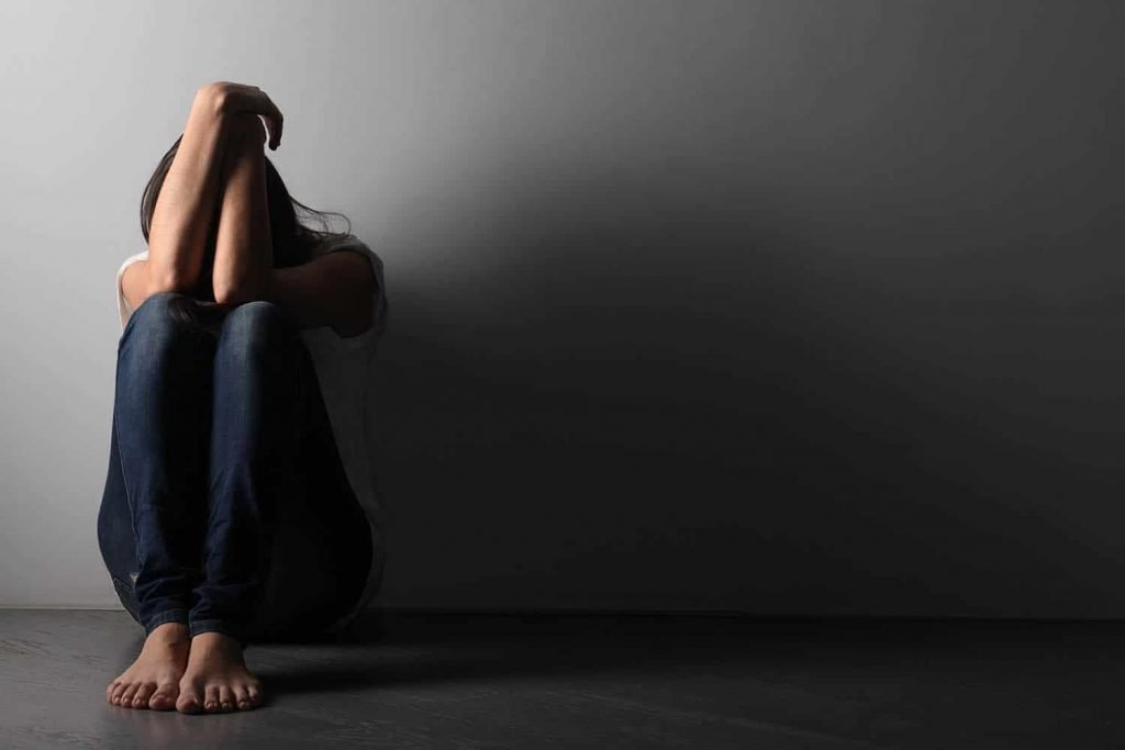 woman sitting alone feeling depressed